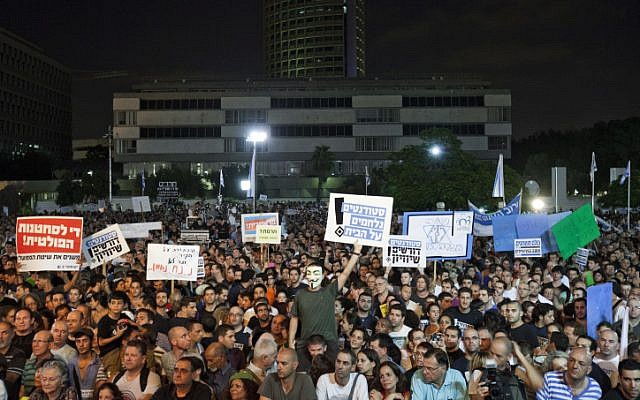 Tens of thousands of people hold a mass rally in Tel Aviv last month, urging the government to enact universal draft legislation (photo credit: Tali Mayer/Flash90)