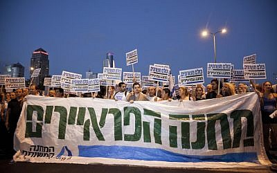 Tens of thousands of people hold a mass rally in Tel Aviv, on Saturday, urging the government to enact universal draft legislation (photo credit: Tali Mayer/Flash90)
