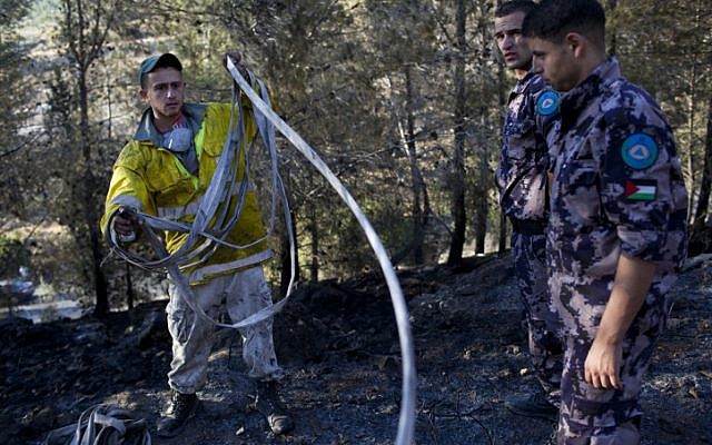 Palestinian and Israeli firefighters fight a blaze in the Jerusalem mountains on Saturday (photo credit: Yonatan Sindel/Flash90)