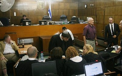 The state's witness, whose identity is under gag order, giving testimony in the Holyland trial last week. (photo credit: Roni Schutzer/Flash90)