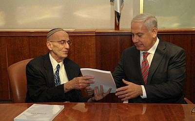 Edmond Levy (left) giving his committee's report to Benjamin Netanyahu last month. (photo credit: Flash90)
