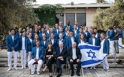 President Shimon Peres with the Israeli Olympic team on July 9. In an agreement with British authorities, Shin Bet bodyguards will travel with the team. (photo credit: Noam Moskowitz/Flash90)