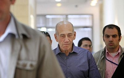 Olmert entering court on Tuesday. (photo credit: Miriam Alster/Flash90)