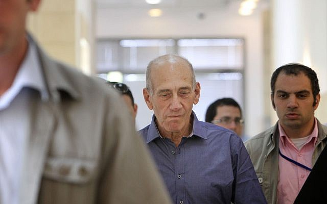 Olmert entering a court room. (photo credit: Miriam Alster/Flash90)