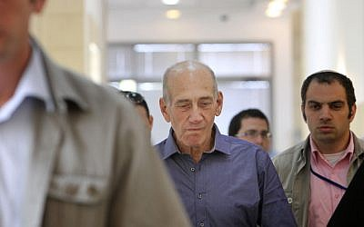 Ehud Olmert arrives at the Jerusaelm District Court to learn his fate, July 10 2012. The court acquitted the former PM on two corruption charges but found him guilty on a third charge of breach of trust. (photo credit: Miriam Alster/Flash90)
