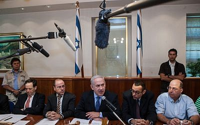 Benjamin Netanyahu, center, speaking to the press in mid-July. (photo credit: Uri Lenz/Flash90)