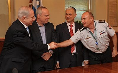 Israeli prime minister Benjamin Netanyahu, Finance Minister Yuval Steinitz and Minister of Public Security Yitzhak Aharonovitch sign an agreement with the The Israel Fire and Rescue Services Monday (photo credit: Moshe Milner/Flash90)