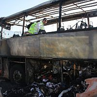 ZAKA emergency rescue worker searches for human remains on a bus that was blown up in a terror attack against Israeli tourists in Burgas, Bulgaria, July 19, 2012. (Dano Monkotovic/Flash90)