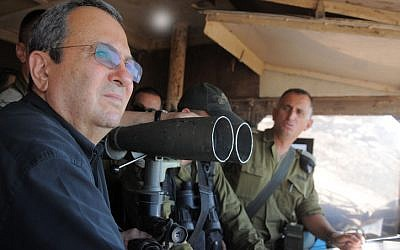 Defence Minister Ehud Barak visits the IDF Northern Command Unit on the Golan Heights, near Syria, July 19, 2012. Images of Barak observing a a battle between the Syrian Army and rebel forces has prompted a wave of sight-seers looking for action. (photo credit: Minisry of Defence/FLASH90)