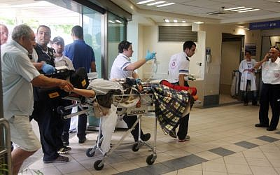 A man injured in the Burgas terror attack arrives in Soroka Hospital Thursday, July 19 (photo credit: Roni Schutzer /Flash90)