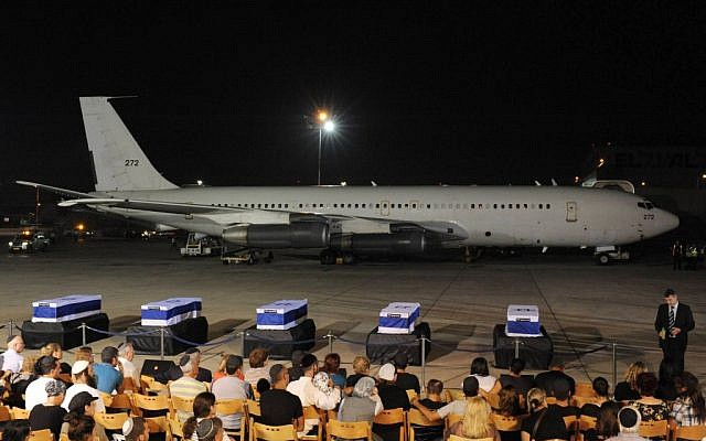 The coffins of the five victims of the Burgas bombing arrive at Ben Gurion airport (photo credit: Amos Ben Gershom/GPO/Flash90)