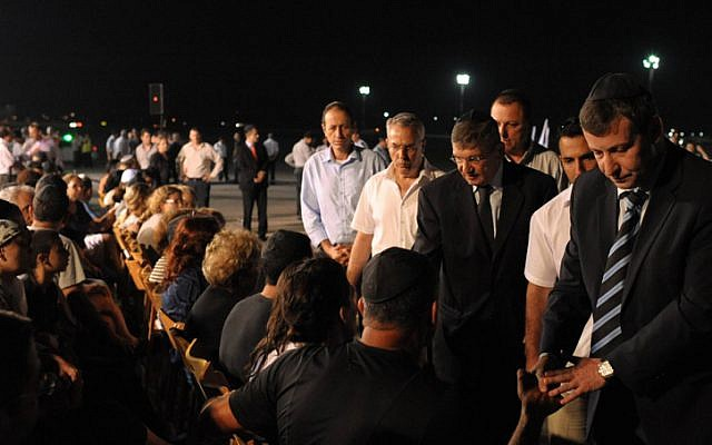 Tourism Minister Stas Misezhnikov attends a ceremony for Israeli victims of  the Burgas terror attack, at Ben Gurion Airport on Friday, July 20 (photo credit: Amos Ben Gershom/GPO/Flash90)