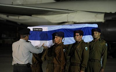 Soldiers unload the coffin of Itzik Kolengi, 28, who was killed in a suicide bombing in Bulgaria on Wednesday, at an official ceremony at Ben-Gurion Airport outside Tel Aviv late Thursday night. (photo credit: Amos Ben Gershom/GPO/Flash90)