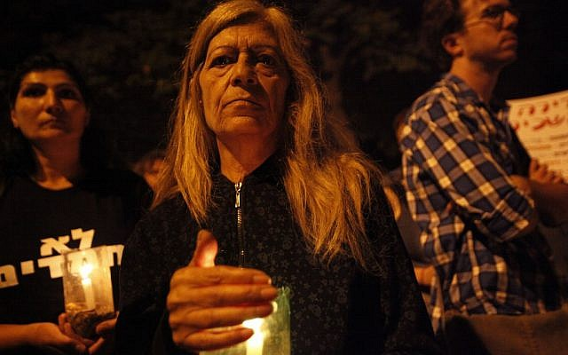 An Israeli woman holds a candle at a memorial march for Moshe Silman (photo credit: Miriam Alster/FLASH90)