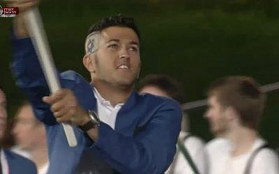 Flag bearer Shahar Zubari, who won an Olympic bronze medal in sailing in 2008, sports a flag-inspired haircut as he marches the Israeli team into the Olympic Stadium at the opening ceremony of the 2012 London Games, Friday, July 28 (image capture Channel 1)