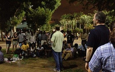 Aaron Frazer speaking at the Livnota b'esh (build it by fire) barbecue to promote conversations between African refugees and Israelis at the Levinsky Park Thursday (photo credit: MIchal Shmulovich)