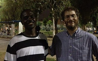 New friends Abu Bakr Abu Karim (left) and Elli Fischer at the Levinsky Park Thursday (photo credit: Michal Shmulovich)