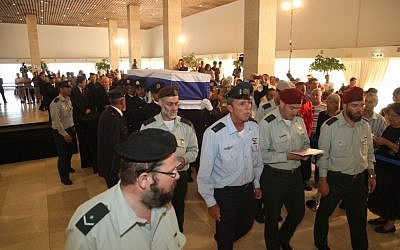 IDF officers bear the coffin of former prime minister Yitzhak Shamir on its way out of the Knesset on Monday. (photo courtesy of the Knesset)