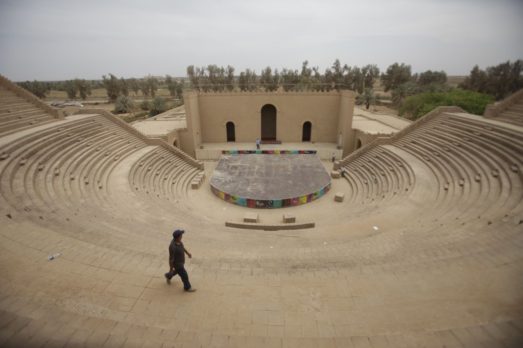A man walks through an amphitheater at the archaeological site of Babylon. (photo credit: AP Photo/Khalid Mohammed)