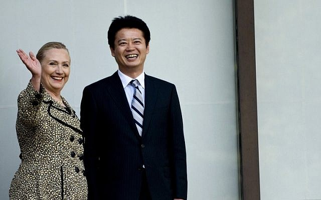 US Secretary of State Hillary Rodham Clinton, left, and Japanese Foreign Minister Koichiro Gemba stand before a meeting in Tokyo on Sunday, July 8 (photo credit: AP/Brendan Smialowski)