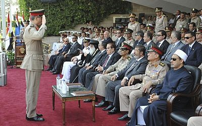 An Egyptian officer salutes Mohammed Morsi during a graduation ceremony Monday (photo credit: (AP Photo/Sheriff Abd El Monem)