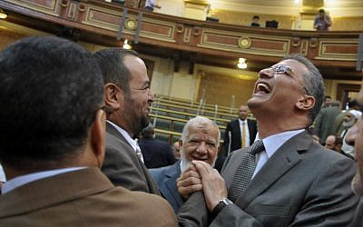 Egyptian lawmakers meet briefly in parliament Tuesday (photo credit: AP photo)