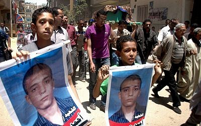 Funeral procession of Ahmed Hussein Eid, who was killed in Suez, Egypt, in July, 2012. (photo credit: AP)