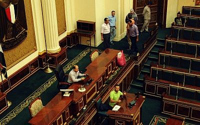 Officials are seen in the Egyptian parliament in Cairo, Egypt, Monday, July 9, 2012. President Mohammed Moris is trying to reconvene the parliament that was previously disbanded by the powerful military leadership. (photo credit:AP/Mohammed Asad)