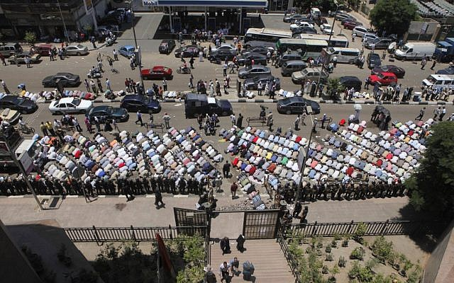 Islamists praying outside a courthouse in Cairo Tuesday. (photo credit: AP/Amr Nabil)