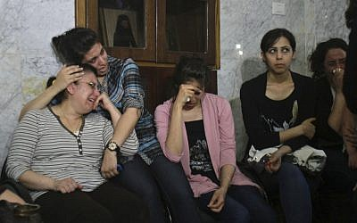 Palestinian Christians cry during a rally against the forced conversions of two individuals. (photo credit: AP/Adel Hana)