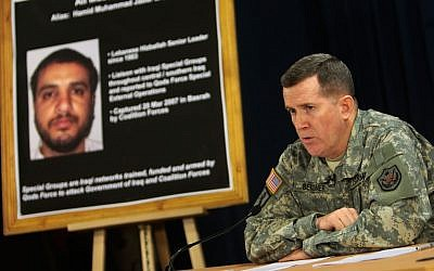 US military spokesman Brig. Gen. Kevin J. Bergner  speaks during a press conference, near a poster of senior Lebanese Hezbollah operative Ali Mussa Daqduq in Baghdad, Iraq, in 2007. (photo credit: Wathiq Khuzaie/AP)