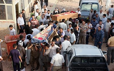 Bombing victims are taken for burial in Najaf, 100 miles south of Baghdad, Iraq, on Tuesday, July 3, 2012. (photo credit: Alaa al-Marjani/AP)