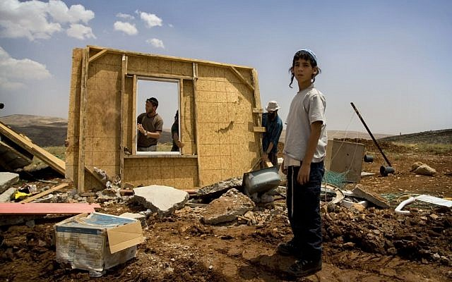 Illustrative Members of the Hilltop Youth try to rebuild a structure demolished earlier by Israeli troops in the West Bank outpost of Maoz Esther, a hilltop site northeast of Ramallah, in May 2009. (Sebastian Scheiner/AP)