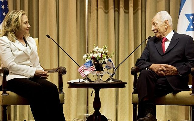 President Shimon Peres and US Secretary of State Hillary Clinton meet at the president's residence in Jerusalem on July 16, 2012. (photo credit: AP/Brendan Smialowski)