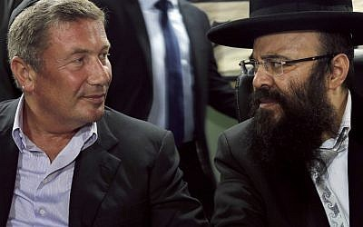 Rabbi Yaakov Israel Ifargan, right, known as the 'X-Ray' rabbi sits next to businessman Nochi Dankner at the annual gathering of the rabbi's followers and supporters in the town of Netivot, on July 1 (photo credit: AP/Tsafrir Abayov)