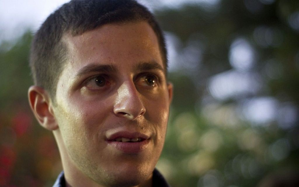 Gilad Shalit attends Bastille Day celebrations at the French Ambassador to Israel Christophe Bigot's residence in Tel Aviv in July. Shalit hasn't given many details about his captivity in Gaza, but he hasn't vanished from sight either. (photo credit: Ariel Schalit/AP)
