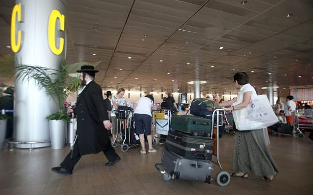 Israelis move through the departure terminal at Ben-Gurion International Airport in Tel Aviv Thursday, July 19, 2012.  (photo credit:AP/Dan Balilty)