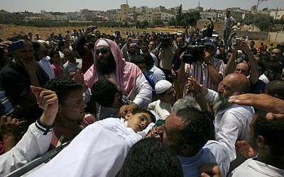 People carry the body of 6-year-old Syrian boy Bilal El-Lababidi during his funeral in Ramtha, Jordan, Friday, July 27, 2012. The boy was shot dead by Syrian border guards, his mother said. (Photo credit: AP/Mohammad Hannon)