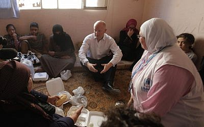 British Foreign Secretary William Hague meets with Syrian refugees in Ramtha, Jordan on Tuesday (photo credit: AP/Mohammad Hannon)