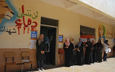 Women stand in line to vote in Benghazi in 2012 (photo credit: AP Photo/Ibrahim Alaguri)