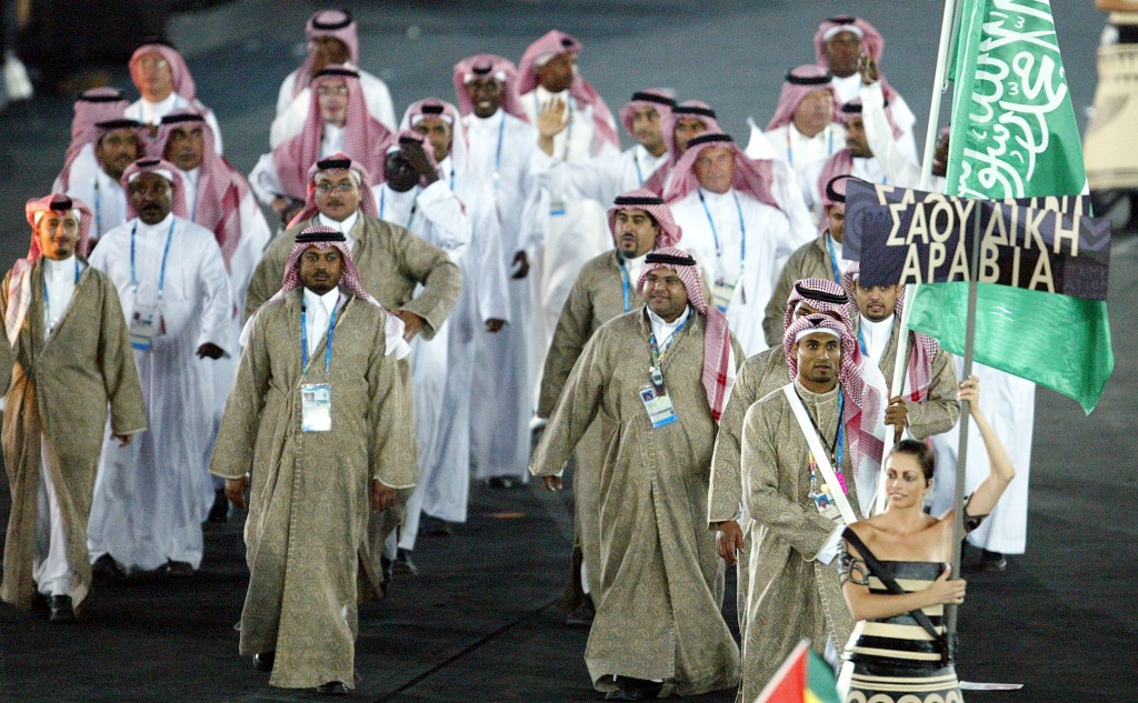 Despite olympic first womens sports remains an underground a saudi athlete carries the flag of saudi arabia during opening ceremonies of the 2004 olympic freerunsca Image collections