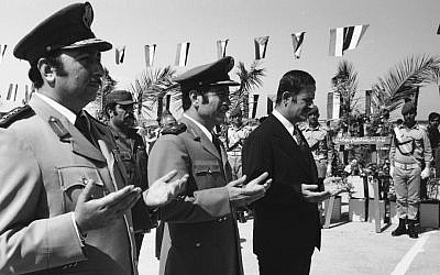 This photo from 1974 shows then Syrian president Hafez Assad (right) and war minister, and father of Manaf Tlas, Gen. Mustafa Tlas (center) taking part in ceremonies in Damascus honoring the Syrian dead on the first anniversary of the the 1973 Yom Kippur War with Israel. (photo credit: AP photo/File)