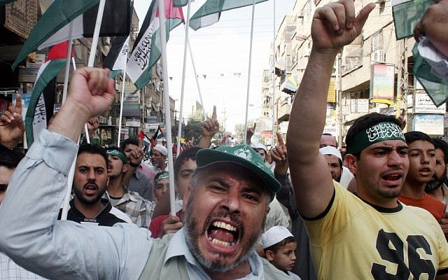 Syrian demonstrators march through the Yarmouk Palestinian refugee camp, near Damascus, to mark Jerusalem Day, in 2007. (photo credit: AP/Bassem Tellawi)