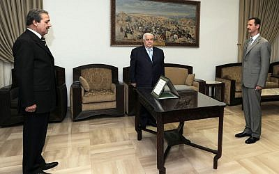Syrian ambassador to Iraq Nawwaf Fares sworn in, 2008 (photo credit: AP Photo/SANA)