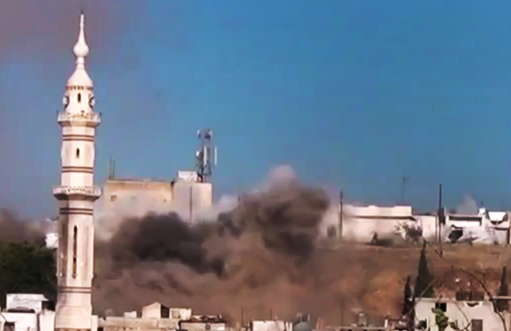 Black smoke rises into the air from shelling near a mosque in Talbiseh, the  central
