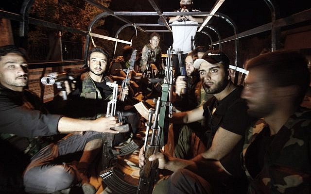 Free Syrian Army soldiers in the border town of Azaz, north of Aleppo, Sunday (photo credit: AP photo/Turkpix)
