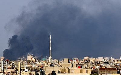 In this citizen journalist image, smoke billows over Damascus, Syria, in July (photo credit: AP)