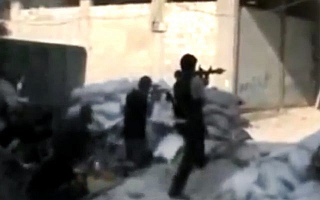 Free Syrian Army soldiers clash with Syrian government forces in Damascus last Sunday (photo credit: AP/Ugarit News)