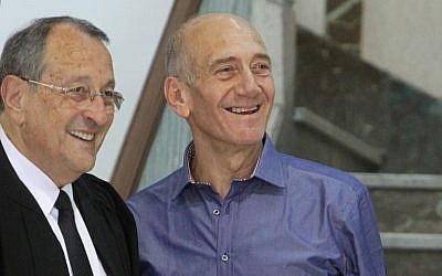 Ehud Olmert, right, and his lawyer, Eli Zohar, after he was cleared of several corruption charges in July (photo credit: Miriam Alster/Flash90)