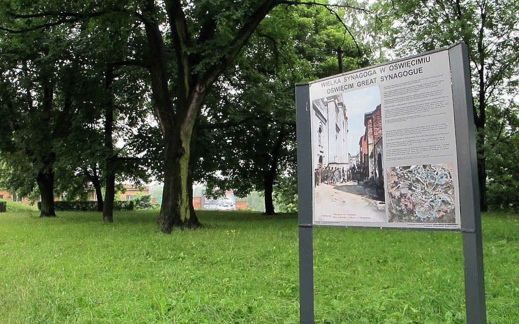 A sign denotes the empty space where the destroyed Great Synagogue in Oswiecim, the town in southern Poland where Auschwitz was built, once stood. (Ruth Ellen Gruber)